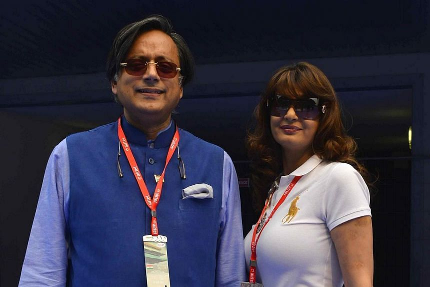 Sunanda Puskhar Tharoor (right), wife of India's Minister of State for Human Resource Development Shashi Tharoor, poses with her husband at the Indian F1 Grand Prix at the Buddh International Circuit in Greater Noida, on the outskirts of New Delhi, o
