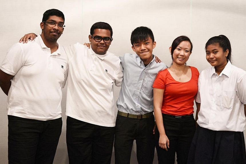 (From left) ITE College West students Iskander Shah, 17, Mohd Mubin, 18, and Benny Chan, 17, programme head and Delta Senior School (DSS) instructor Valerie Lim and DSS student Seti Humaira, 17, pictured before the launch of the buddy programme by Th