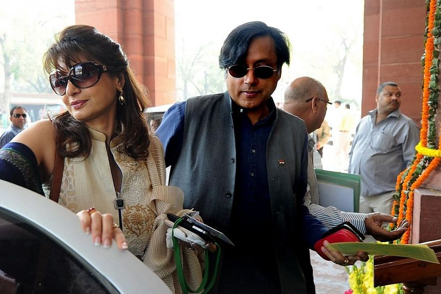Ex-junior minister for external affairs and Congress Party's Member of Parliament Shashi Tharoor (right) with his wife Sunanda Pushkar arrive at parliament for the opening of the budget session in New Delhion March 12, 2012.An autopsy rep