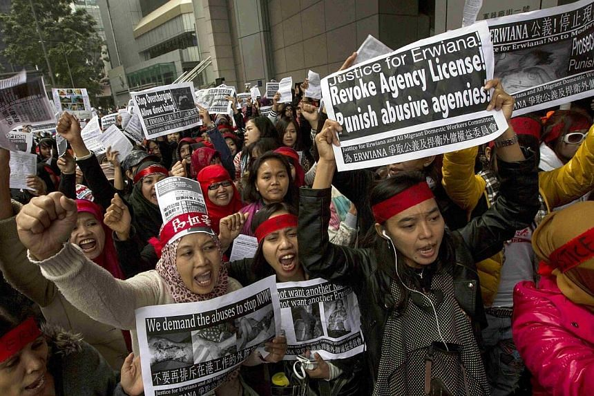 Thousands of people rallied in Hong Kong on Sunday to demand justice for a young Indonesian maid who was badly beaten by her employer in a case that has sparked widespread outrage and a police investigation into accusations of torture. -- PHOTO: AFP