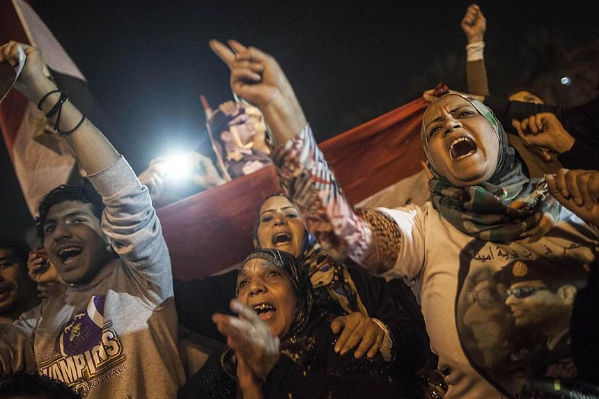 Egyptians celebrate in Tahrir square after a new constitution was approved on Jan 18, 2014 in the capital Cairo. More than 98 per cent of Egyptians backed a new constitution in a referendum, authorities said on Saturday, though the turnout was lower