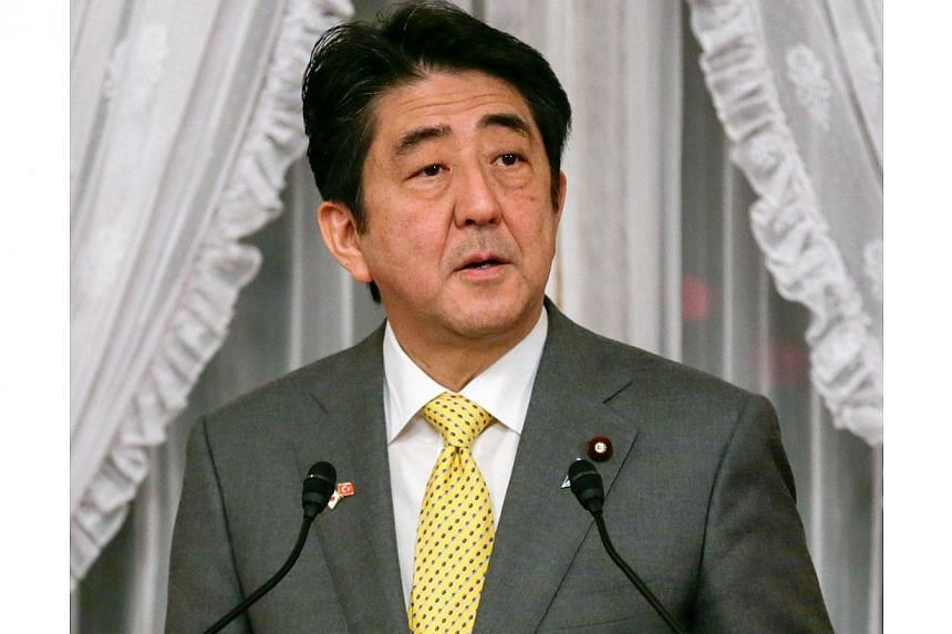 "Japanese Prime Minister Shinzo Abe called on Sunday for ""frank"" summit talks with China and South Korea to help solve historical and territorial disputes that have soured ties between the neighbours. -- FILE PHOTO: AFP"