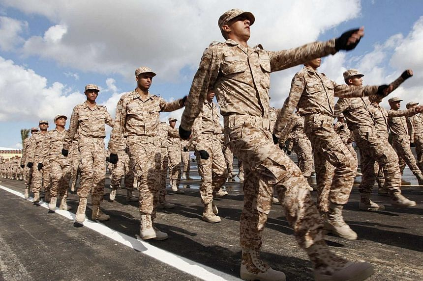 Soldiers march during a graduation ceremony for recruits of the Libyan army in Tripoli January 16, 2014. Libya's General National Congress declared a state of emergency in the country on Saturday, Jan 18, 2014, an official said, after fresh clashes e