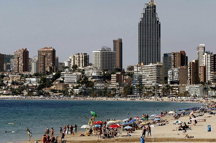 A file picture taken on Sept 24, 2013 shows the beach and surounding housing buildings in Benidorm. Record numbers of foreign tourists poured into Spain in 2013 to bake on sunny beaches but a new challenge lies ahead: luring them to holiday spots inl