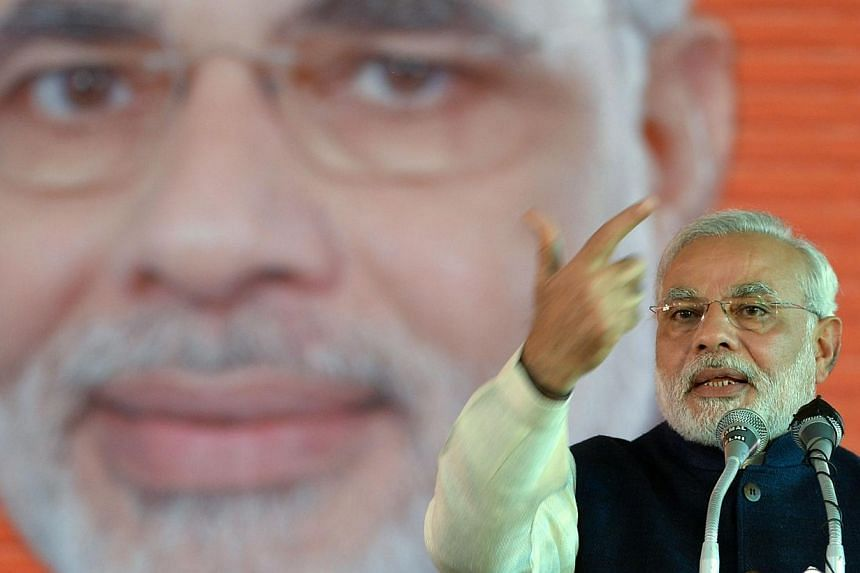 India's opposition prime ministerial candidate Narendra Modi speaks during the party's national council meeting at Ramlila grounds in New Delhi on Sunday, Jan 19, 2014. Mr Modi mocked the ruling Congress party on Sunday for refusing to name