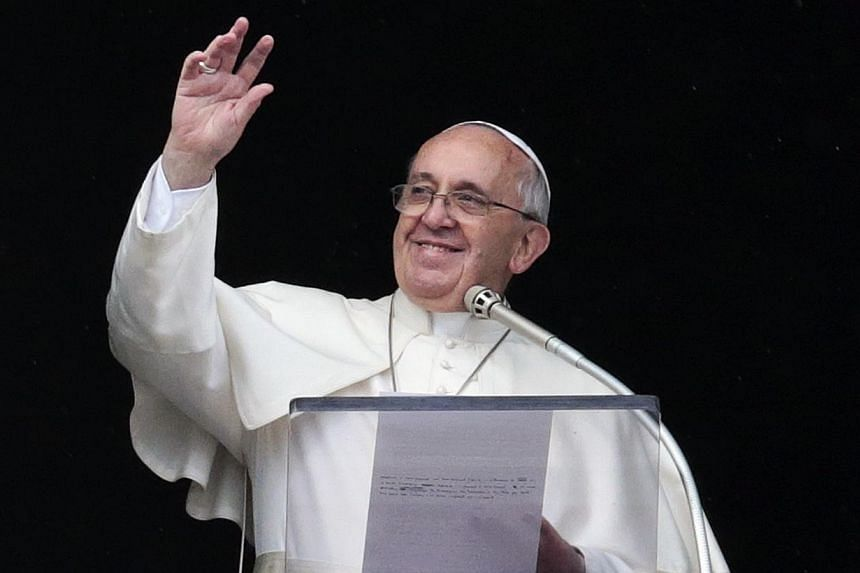 """Pope Francis on Sunday spoke out about the plight of refugees and the traffickers who want to """"enslave"""" them ahead of a visit to a parish near Rome's main railway station that cares for immigrants and homeless people. -- PHOTO: REUTERS"""