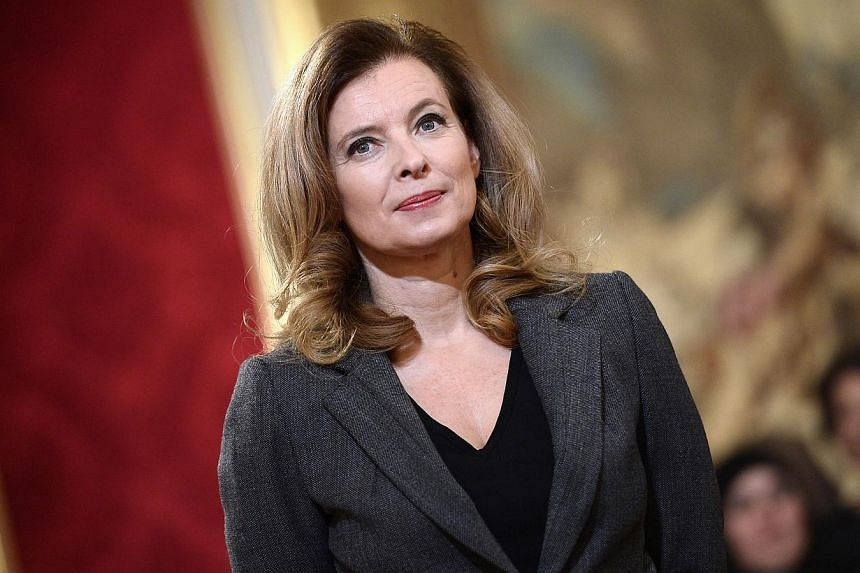 """This picture taken on Nov 30, 2013 shows French president's companion Valerie Trierweiler during a """"Family Medal"""" ceremony at the Elysee palace in Paris. President Francois Hollande's partner Valerie Trierweiler had left the hospital she had entered"""