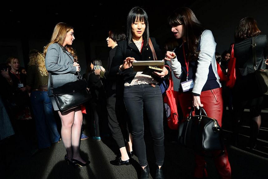 Women entrepreneurs taking part in three-minute, one-on-one, business speed dating meetings during the fourth Women Entrepreneurs Festival in New York on Jan 15, 2014. -- PHOTO: AFP
