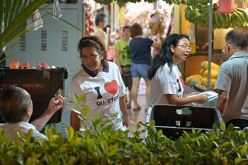 Volunteer anti-smoking advocates Irene Tan, 50 (left), and Fanny Oei, 43, giving out flyers near Nee Soon South Community Club. They are among 20 volunteers helping to raise awareness about the smoke-free zone.