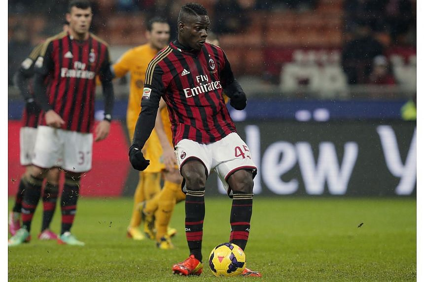 Mario Balotelli scores a penalty during the Serie A football match AC Milan vs Verona at San Siro stadium in Milan on Jan 19, 2014.Clarence Seedorf made a winning start as AC Milan coach thanks to a late Mario Balotelli penalty which gave his s