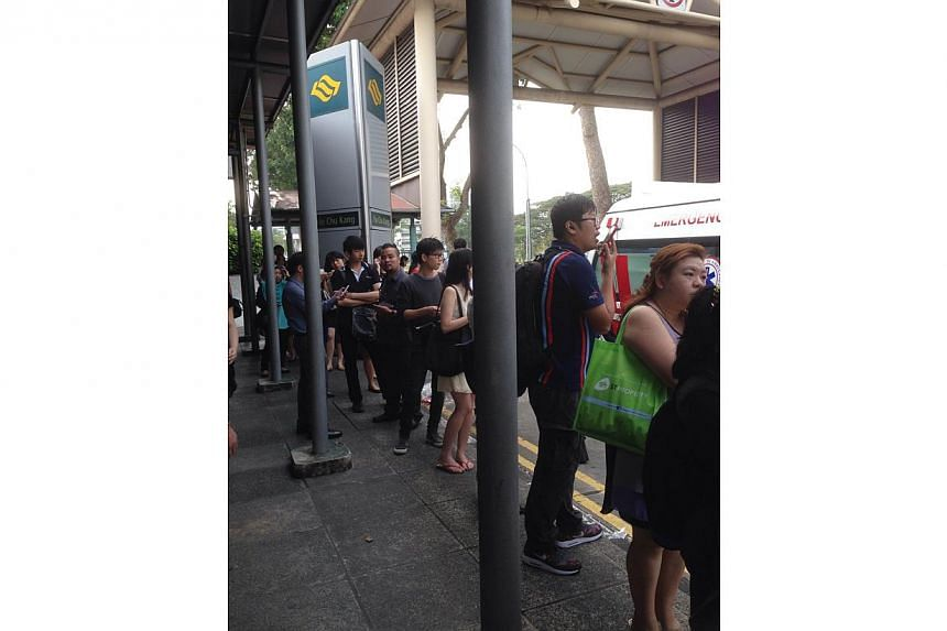 Long queue for bridging bus service at Yio Chu Kang MRT station. A train fault occurred on the North-South Line on Monday morning. -- ST PHOTO: ONG HWEE HWEE