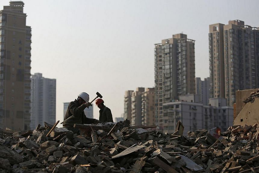 China's economy grew 7.7 per cent last year, the government said on Monday, in line with expectations and the same as 2012, when it recorded its slowest expansion in 13 years. -- FILE PHOTO: REUTERS