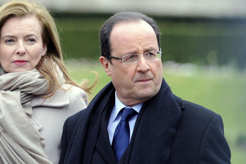 """French President Francois Hollande and his partner Valerie Trierweiler leaving the Prefecture of Correze in Tulle, on April 6, 2013. French President Francois Hollande said Monday his partner is doing """"better"""" and """"resting"""" following a week's stay in"""