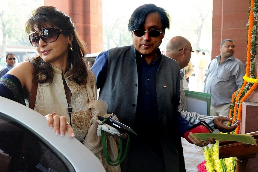 Indian minister Shashi Tharoor (right) with his wife Sunanda Pushkar arrive at parliament for the opening of the budget session in New Delhi, on March 12, 2012. Ms Sunanda Pushkar may have died of a drug overdose, a panel of doctors has reported