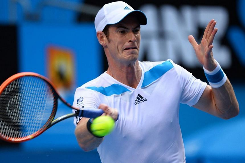 Andy Murray of Britain hits a shot against Stephane Robert of France during their men's singles match on day eight of the 2014 Australian Open tennis tournament in Melbourne, on Jan 20, 2014. Andy Murray smashed a racket in a rare display of frustrat