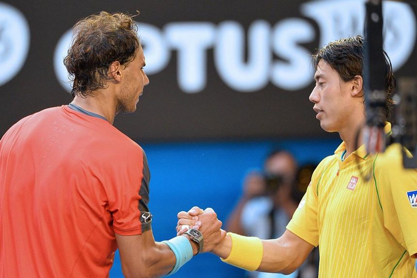 Spain's Rafael Nadal (left) shakes hands after victory in his men's singles match against Japan's Kei Nishikori (right) on day eight of the 2014 Australian Open tennis tournament in Melbourne, on Jan 20, 2014. -- PHOTO: AFP