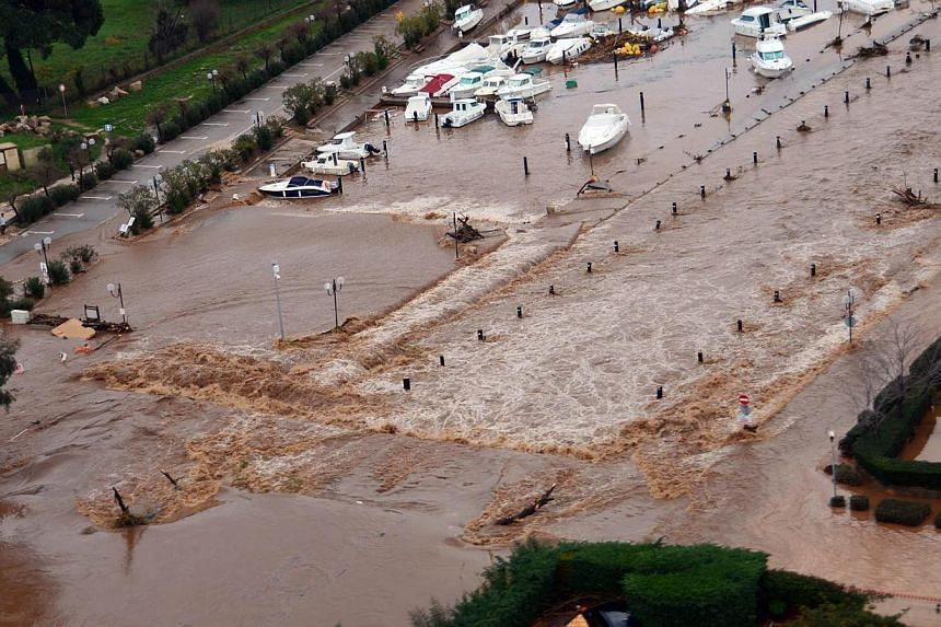 A handout picture taken and released on Jan 19, 2014 by the French Marine Nationale shows an aerial view of the Ayguade seaport in Hyeres, after floods struck south-eastern France. -- PHOTO: AFP