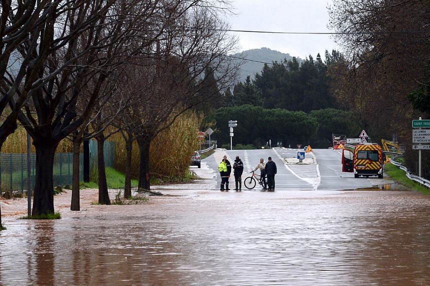 A road is covered by floodwaters after heavy rainfall and the overflow of the Gapeau river the previous days, in Hyeres, on Jan 19, 2014. -- PHOTO: AFP