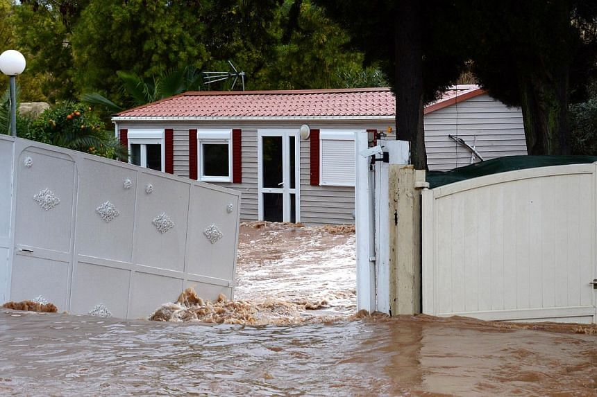 A house is surrounded by floodwaters after heavy rainfall and the overflow of the Gapeau river the previous days, in Hyeres, on Jan 19, 2014. -- PHOTO: AFP