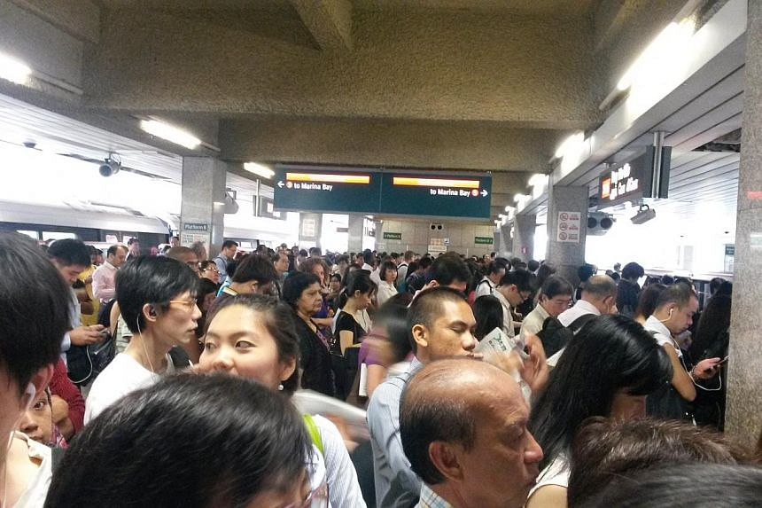 Situation at Ang Mo Kio MRT station this morning.Train services on the North-South line between Sembawang and Marina Bay stations have resumed, train operator SMRT said in a Twitter update at about 9.50am. -- ST PHOTO: JANICE TAI