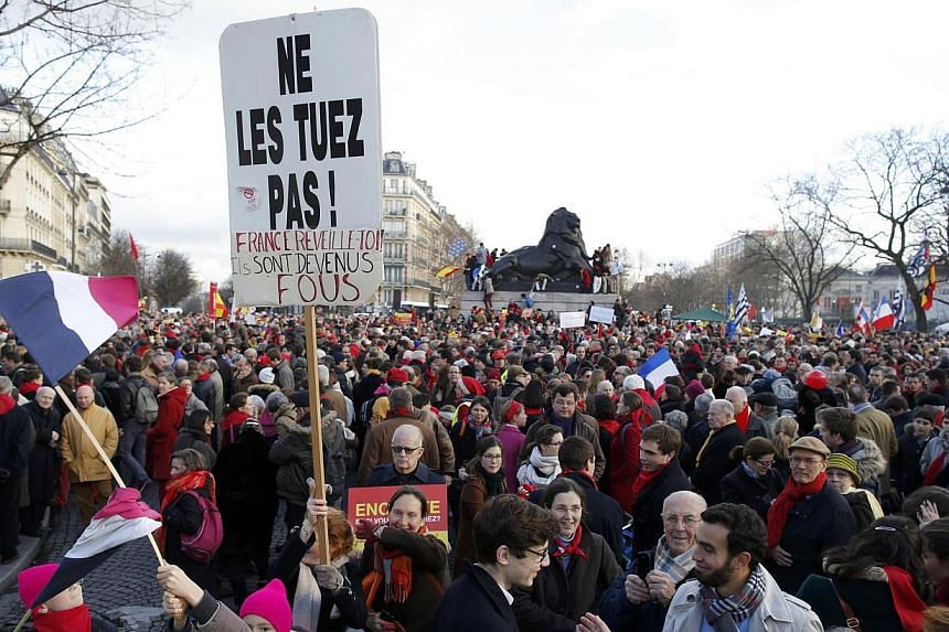 """Several thousand people gather in a square to attend the """"Marche Pour la Vie"""" (March for Life) anti-abortion protest march on the eve of an ammendment vote at the National Assembly in Paris, on Jan 19, 2014. -- PHOTO: REUTERS"""