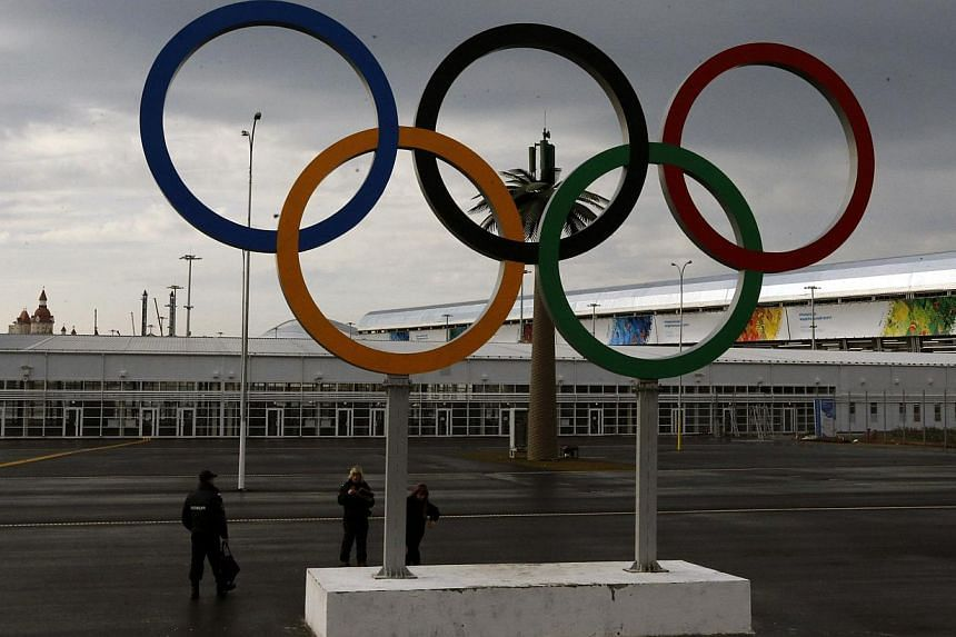 A police officer (left) stands near Olympic rings at the Olympic Park in the Adler district of Sochi on Jan 18, 2014. United States lawmakers raised concerns on Sunday about the threat of attacks at the upcoming Winter Olympics in Sochi, with on