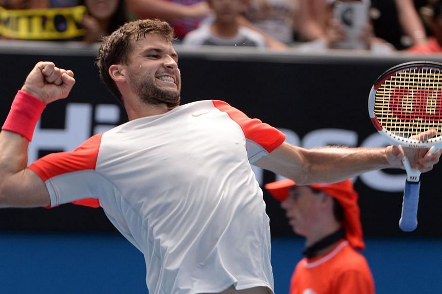 Grigor Dimitrov of Bulgaria celebrates his win over Roberto Bautista Agut (right) of Spain following their men's singles match on day eight of the 2014 Australian Open tennis tournament in Melbourne on Jan 20, 2014. -- PHOTO: AFP
