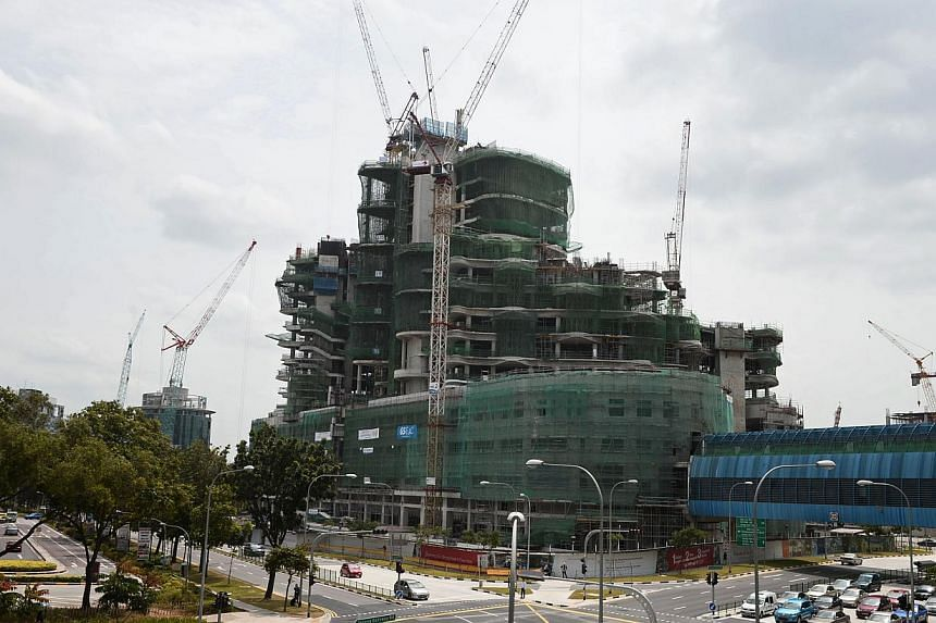 The Ng Teng Fong hospital in Jurong, which is currently under construction, on Jan 20, 2014.A one-tonne slab of cement was hoisted to the roof of the new Ng Teng Fong General Hospital in Jurong as part of the hospital's topping-out ceremo