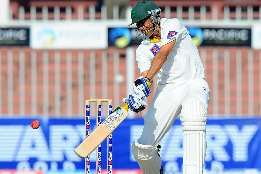 Pakistani batsman Younis Khan plays a shot during the final day of the third and final cricket Test match between Pakistan and Sri Lanka at the Sharjah International Cricket Stadium, in the Gulf emirate of Sharjah, on Jan 20, 2014. Pakistan pull
