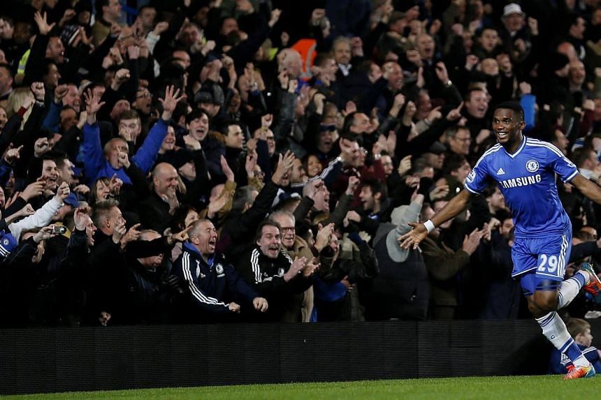 Chelsea's Samuel Eto'o celebrates after scoring his third goal during their English Premier League soccer match against Manchester United at Stamford Bridge in London, on Jan 19, 2014. An Eto'o hat-trick lifted Chelsea to a 3-1 win over Manchester Un