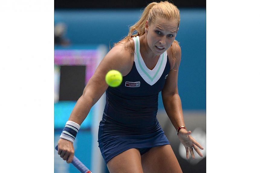 Slovakia's Dominika Cibulkova plays a shot during her women's singles match against Russia's Maria Sharapova on day eight of the 2014 Australian Open tennis tournament in Melbourne on Jan 20, 2014. -- PHOTO: AFP