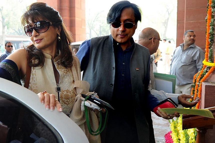 Ex-junior minister for external affairs and Congress Party's Member of Parliament Shashi Tharoor (right) with his wife Sunanda Pushkar arrive at parliament for the opening of the budget session in New Delhion March 12, 2012.Mr Tharoor app