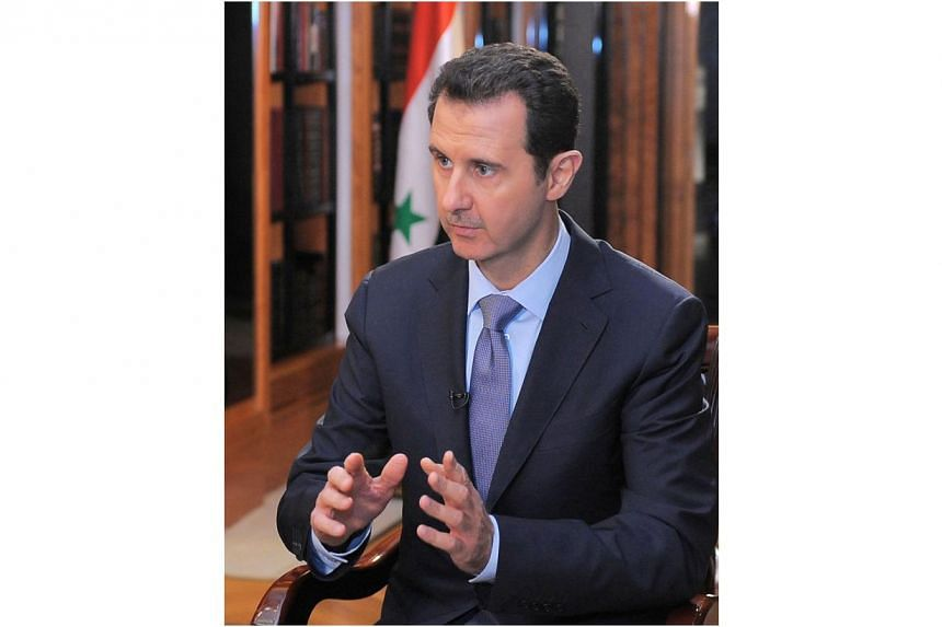 "Syria's President Bashar al-Assad said there is a ""significant"" chance he will seek a new term and ruled out sharing power with the opposition seeking his ouster, in an exclusive interview with AFP before the Geneva II peace talks. -- PHOTO: AFP"