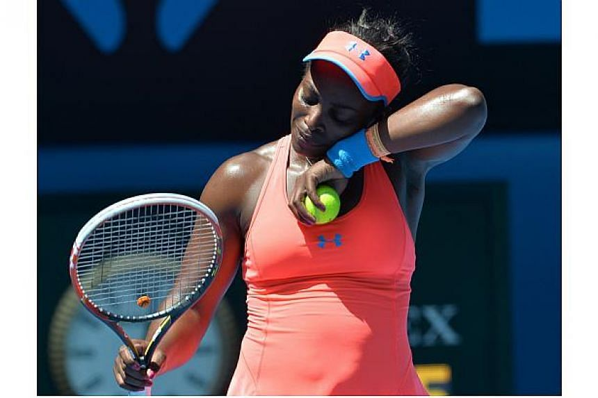 Sloane Stephens of the US gestures during her women's singles match against Belarus's Victoria Azarenka on day eight of the 2014 Australian Open tennis tournament in Melbourne on Jan 20, 2014. -- PHOTO: AFP