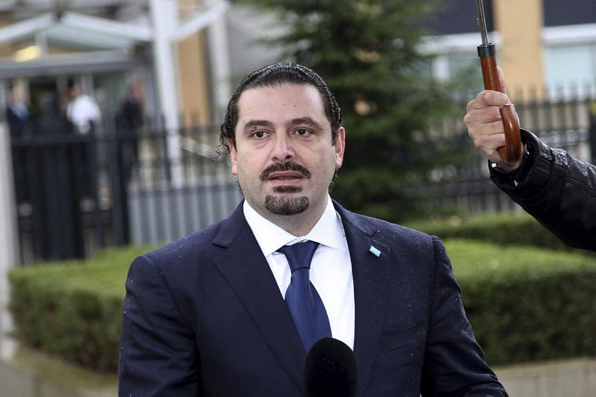 Former Lebanese prime minister Saad Hariri, exiled in France since 2011, said Monday he would return to his country for November legislative elections, adding that he hoped to become premier again.-- FILE PHOTO: REUTERS