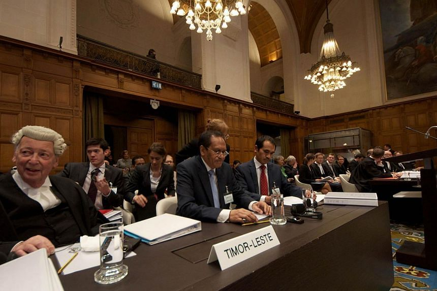 Timor Leste's Foreign Affairs minister Jose Luis Gutierrez (C) attends an audience of the International Court of Justice (ICJ) in The Hague, on January 20, 2014. Tiny, young Timor Leste has dragged Australia before the United Nations' top court this