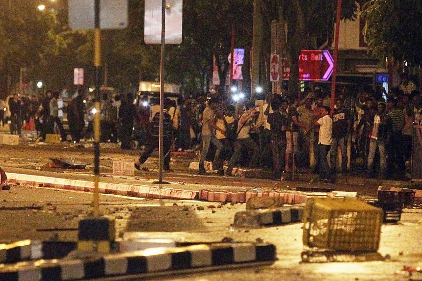 A riot involving almost 400 people broke out along Race Course Road in Little India on Dec 8 last year. -- ST PHOTO: MARK CHEONG
