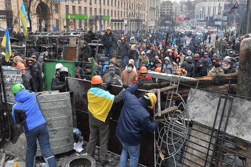 At least 35 reporters have been wounded in the clashes between security forces and protesters in Kiev over the last days, a Ukrainian media rights group said Tuesday, Jan 21, 2014, with two journalists who were detained saying they were beaten by pol