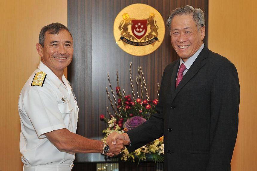 The Commander of the United States Pacific Fleet Admiral Harry Harris called on Defence Minister Ng Eng Hen on Jan 21, 2014, as part of his three-day introductory visit to Singapore. -- PHOTO: MINDEF