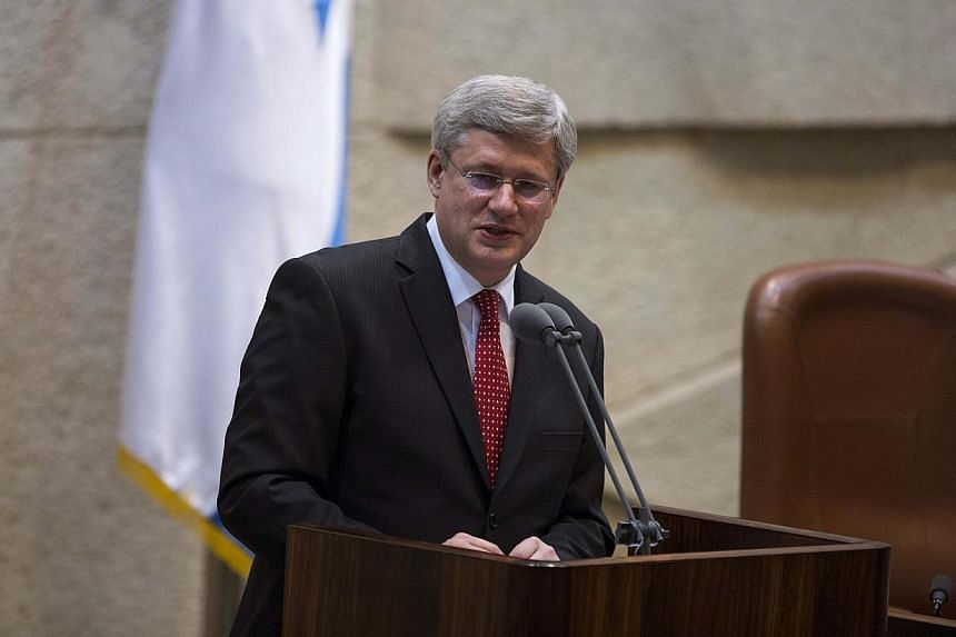 Canada's Prime Minister Stephen Harper delivers a speech at the Knesset, the Israeli parliament, in Jerusalem Jan 20, 2014. MrHarper was shouted down by Arab lawmakers at the Israeli Knesset on Monday, in a speech which won him a standing ovati