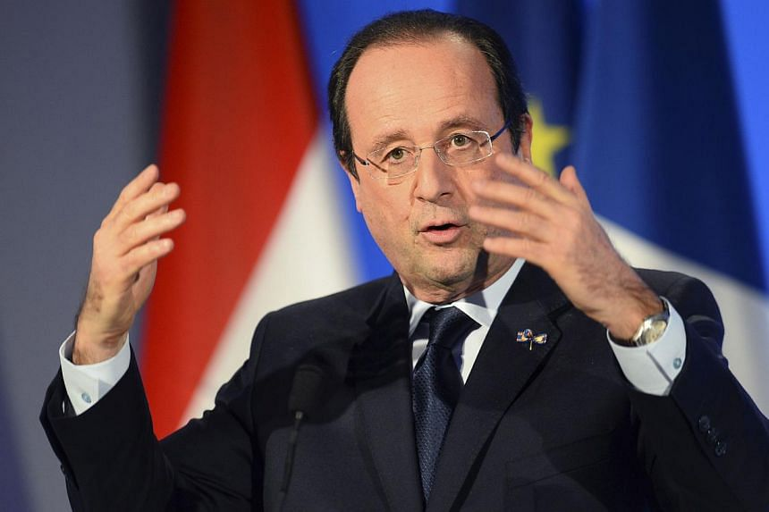 French President Francois Hollande speaks after his meeting with business chief executives during a one-day visit to Amsterdam on Jan 20, 2014.As Mr Hollande wades through the fallout of revelations he has been having an affair with an actress,
