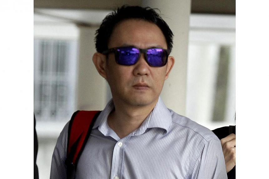 Kwek Chuan Shan, 35 was jailed for 12 months on Tuesday for two counts of having sex with a 15-year-old female student. - ST PHOTO: WONG KWAI CHOW