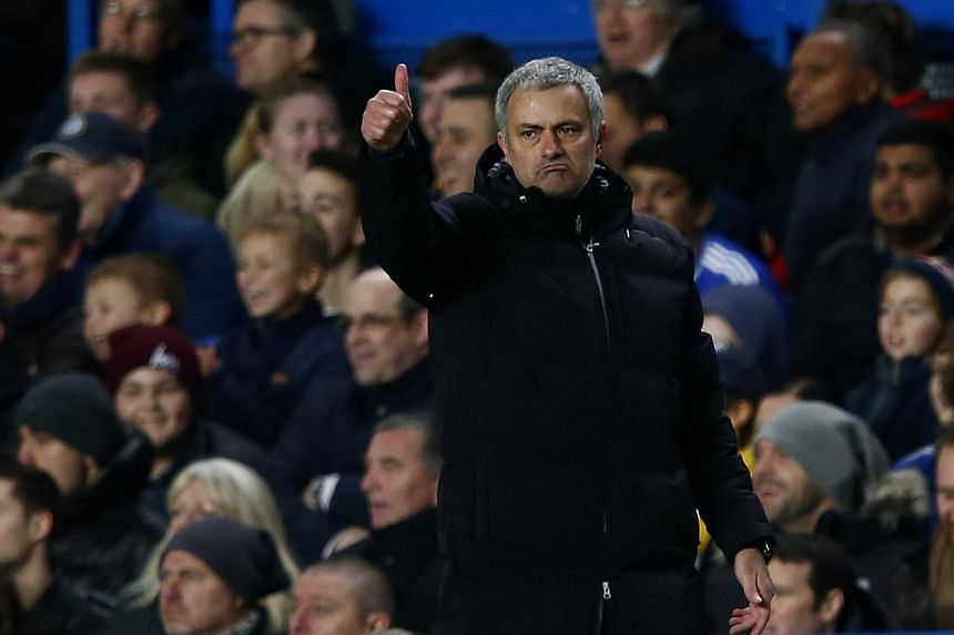 Chelsea's manager Jose Mourinho gestures during their English Premier League soccer match against Manchester United at Stamford Bridge in London, Jan 19, 2014. Mourinho has undergone an operation on his elbow in a bid to cure a longstanding complaint