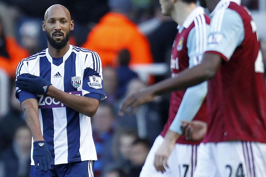 West Bromwich Albion's French striker Nicolas Anelka gestures as he celebrates scoring their second goal during the English Premier League football match between West Ham United and West Bromwich Albion at The Boleyn Ground, Upton Park in east London