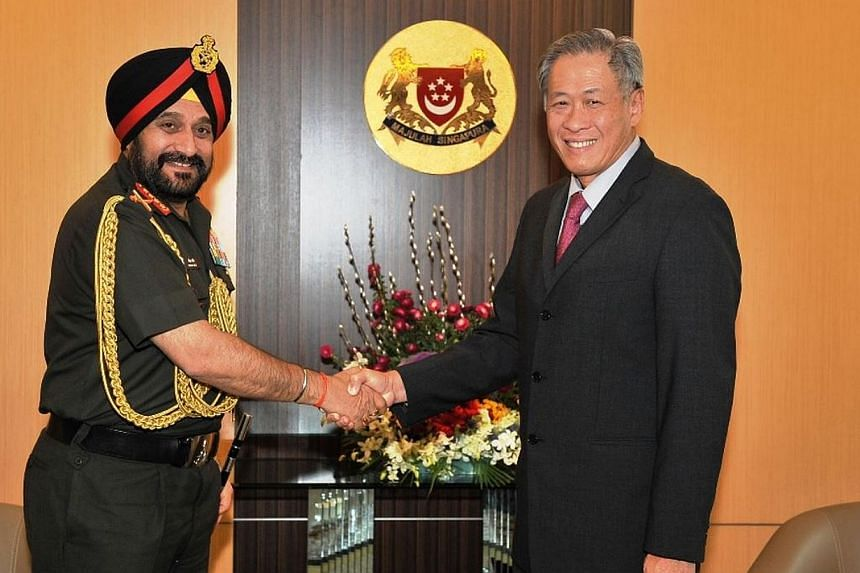 General Bikram Singh, India's Chief of Army Staff,calling on Defence Minister Ng Eng Henat the Ministry of Defence on Thursday, Jan 21, 2014. Gen Singhis in Singapore for the first time since he took the top job in 2012.-- PHO