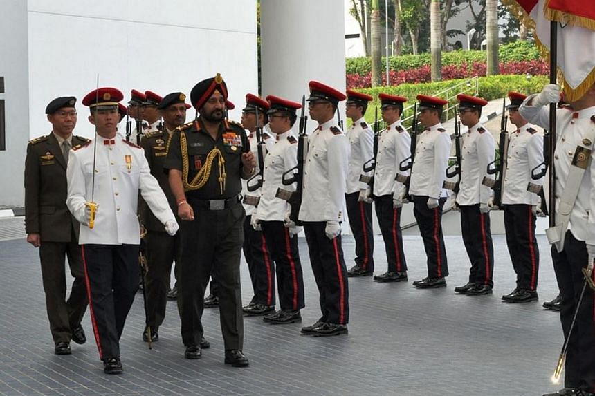General Singh inspecting a guard of honour at the Ministry of Defence.-- PHOTO: MINDEF