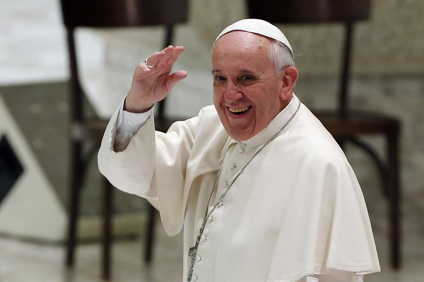 """Pope Francis waves at the end of an audience with Rai Television employers at the Paul VI Hall in Vatican, on Jan 18, 2014.President Barack Obama will visit Vatican City in March to meet Pope Francis, whom he has praised as an """"eloquent"""" spokes"""