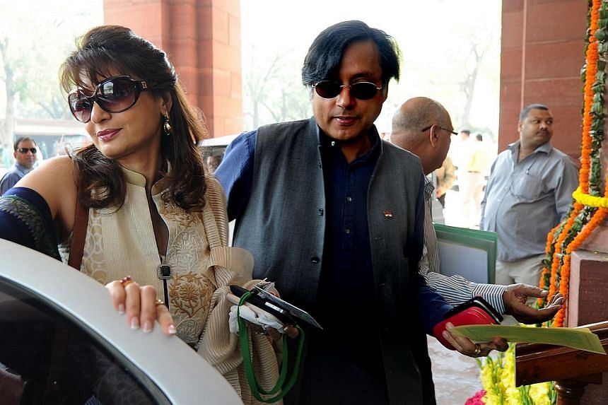 Indian minister Shashi Tharoor (right), with his wife Sunanda Pushkar, arrive at parliament for the opening of the budget session in New Delhi, on March 12, 2012. An overdose of anti-depressant drugs likely caused Ms Sunanda's death, accord