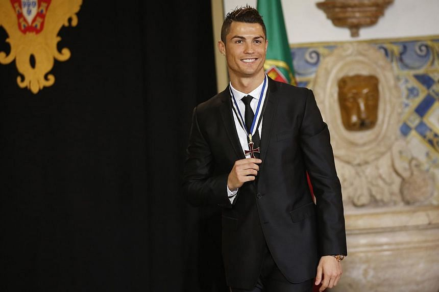 Portugal's soccer team captain Cristiano Ronaldo poses after receiving the Ordem do Infante Dom Henrique in Lisbon on Jan 20, 2014.Ronaldo was on Monday awarded one of the most prestigious honours in Portugal from the country's President Anibal
