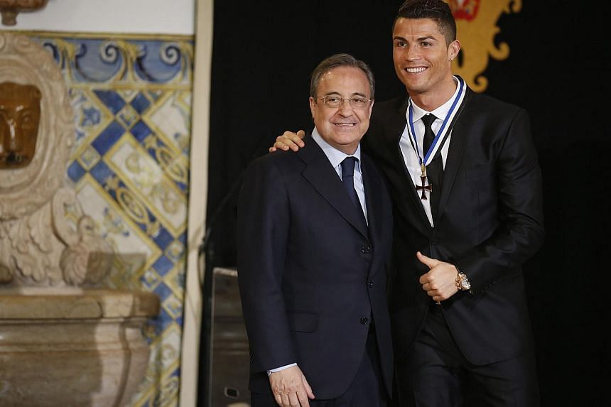 Portugal's soccer team captain Cristiano Ronaldo poses with Real Madrid's President Florentino Perez (right) after receiving the Ordem do Infante Dom Henrique in Lisbon on Jan 20, 2014. -- PHOTO: REUTERS